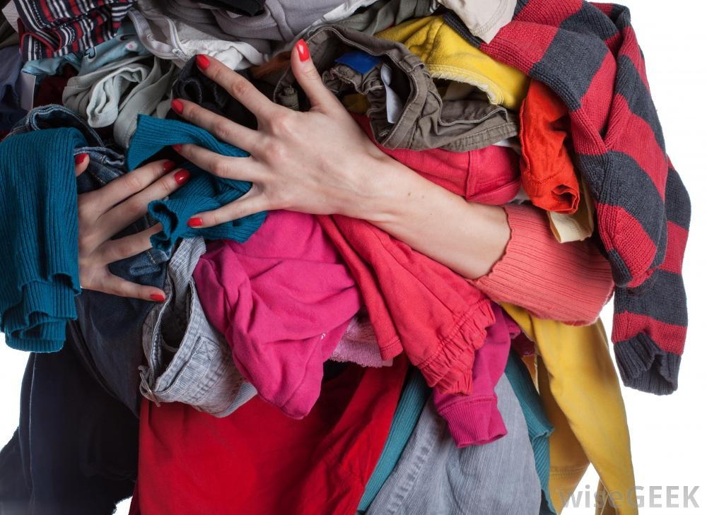 woman-holding-pile-of-clothes